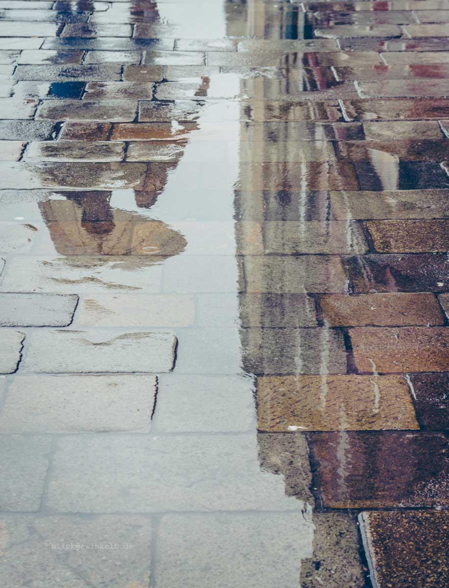 Regenpfütze Spiegelung